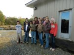 The ACDS 8th grade class poses in front of the conservation barn.