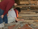 Students check out the tagging system on each artifact extracted from the house. The tag tells the year the piece was extracted, and which number piece it was to be extracted.