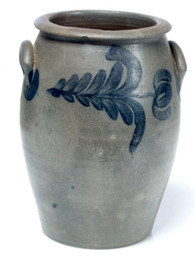 Second quarter 19th century, semi-ovoid jar having applied lunate handles and brushed tulip and leaf designs surrounding the exterior; attributed to Virginia. Image courtesy of Cowan's Antiques.