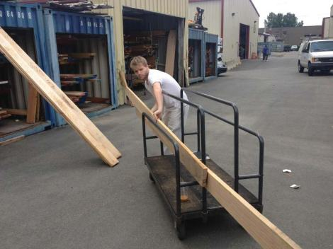 Alex at the Anderson Quaid Co, Inc. purchasing site model wood.