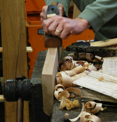 The hand lathe is a great way to smooth off the side of a board to a nice, even finish.