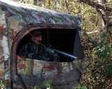 Robin Clark looks out from his blind during the muzzleloader hunt.