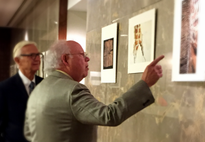 Former law school classmates, Moore gave a personal tour of his photos to Pres. Reveley.
