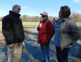Preservantion architect, John Fidler and Menokin Trustee, Mercer O'Hara, chat with Sarah.