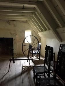 Spinning wheel in a garret room