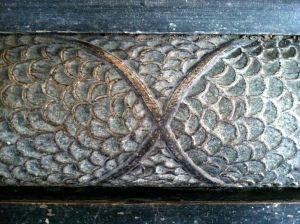 "Fish scale motif and ""X"" carved into Menokin mantle piece. Photo by Leslie Rennolds"