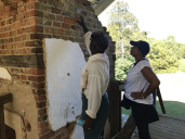 Joe McGill and Lauranett Lee search for more fingerprints in the chimney bricks.