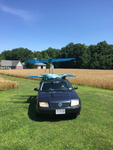 Alice turned her car into a modified flying machine while transporting the rack to the creek.
